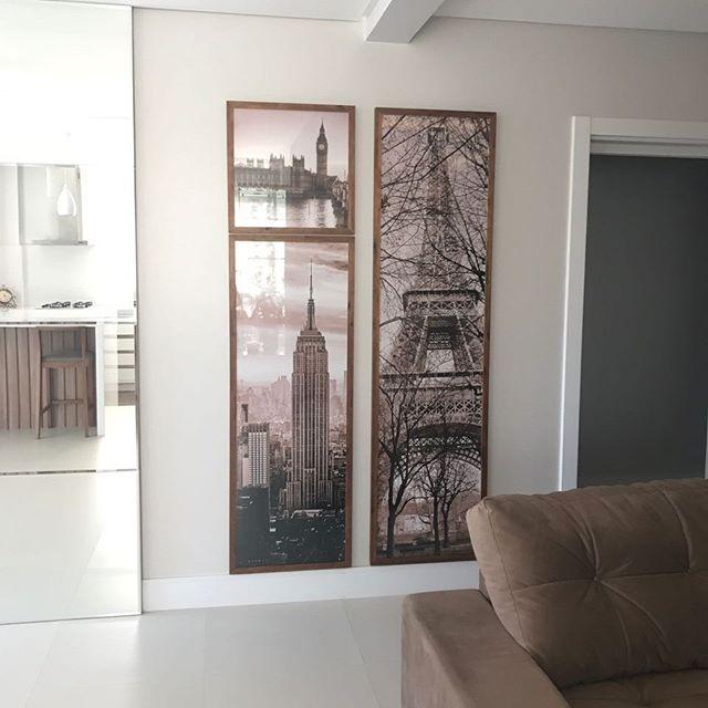 Trio de quadros cidades com imagem em sépia.